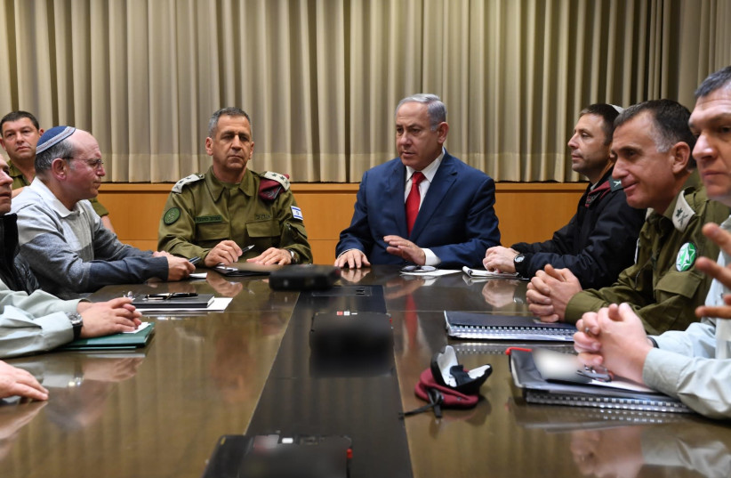 Prime Minster and Defense Minister Benjamin Netanyahu speaks to the security cabinet after convening it to discuss Gaza rockets fired at Tel Aviv (photo credit: ARIEL HERMONI / DEFENSE MINISTRY)