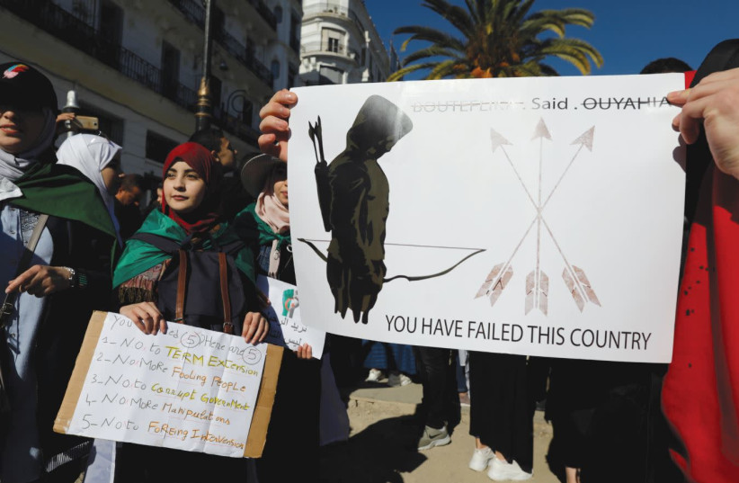 Students carry banners during a protest against Algerian President Abdelaiz Boutleflika in Algiers this week   (photo credit: ZOHARA BENSEMRA / REUTERS)