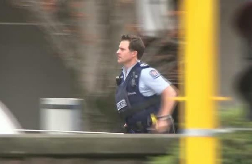 A police officer is seen after reports that several shots had been fired at a mosque, in central Christchurch, New Zealand March 15, 2019, in this still image taken from video. (photo credit: REUTERS)