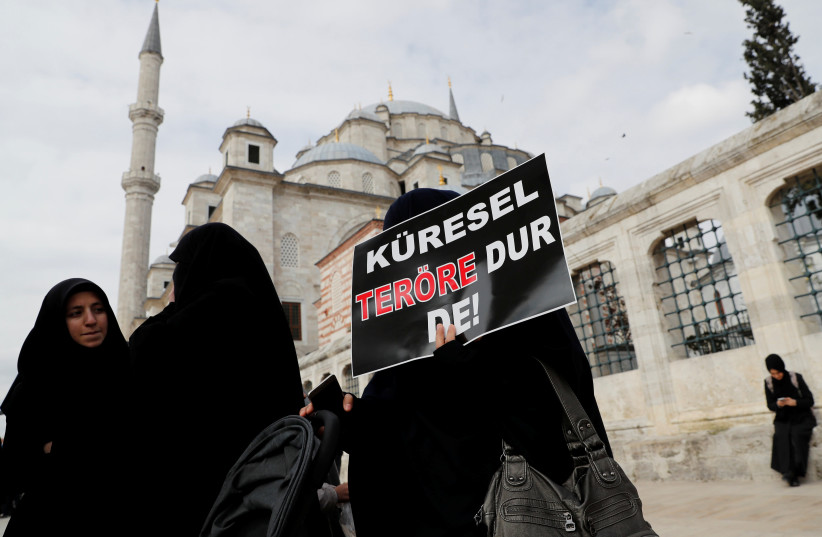 Women take part in a demonstration to protest against the Christchurch mosque attack in New Zealand, Istanbul, Turkey, 2019. (photo credit: REUTERS/MURAD SEZER)
