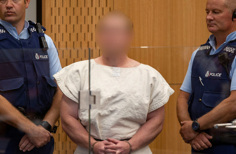 Brenton Tarrant, charged for murder in relation to the mosque attacks, is seen in the dock during his appearance in the Christchurch District Court (photo credit: MARK MITCHELL/NEW ZEALAND HERALD/POOL VIA REUTERS)