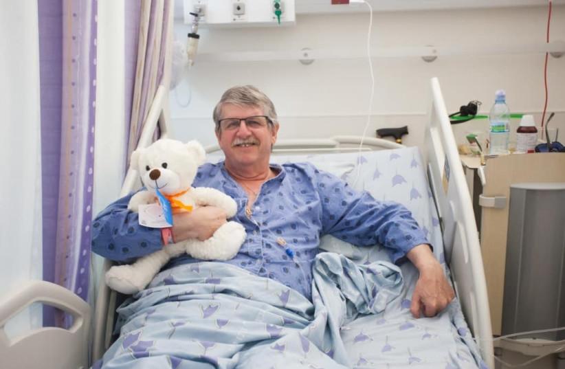 A patient at Tel Aviv's Ichilov Hospital receives a teddy bear from charity Healing Teddies  (photo credit: KARIN MAGEN)