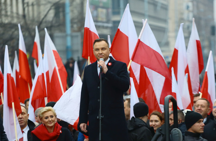 Poland's President Andrzej Duda delivers a speech before the official start of a march marking the 100th anniversary of Polish independence in Warsaw, Poland November 11, 2018. (photo credit: AGENCJA GAZETA/ADAM STEPIEN VIA REUTERS)