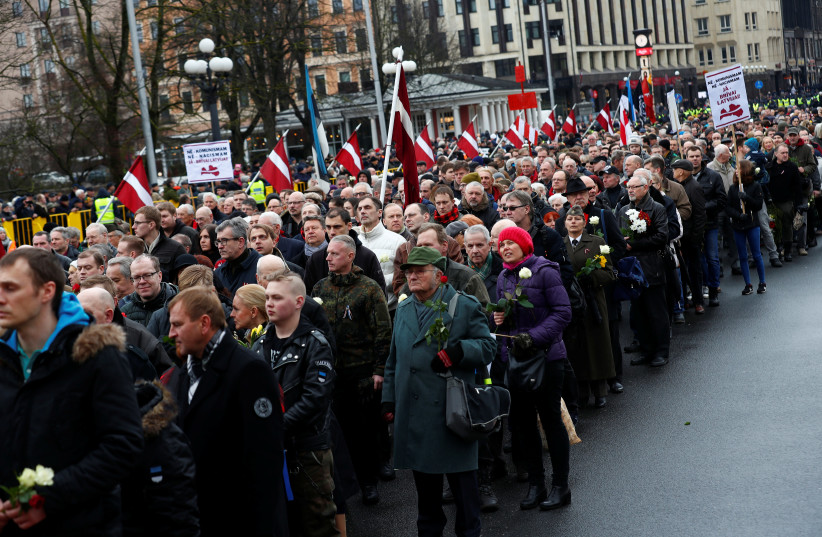 People attend the annual procession to commemorate the Latvian Waffen-SS (Schutzstaffel) unit, also known as the Legionnaires in Riga, Latvia (photo credit: REUTERS)