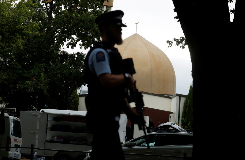 A police officer patrols outside Masjid Al Noor mosque after Friday's mosque attacks in Christchurch, New Zealand, March 16, 2019.  (photo credit: REUTERS/JORGE SILVA)