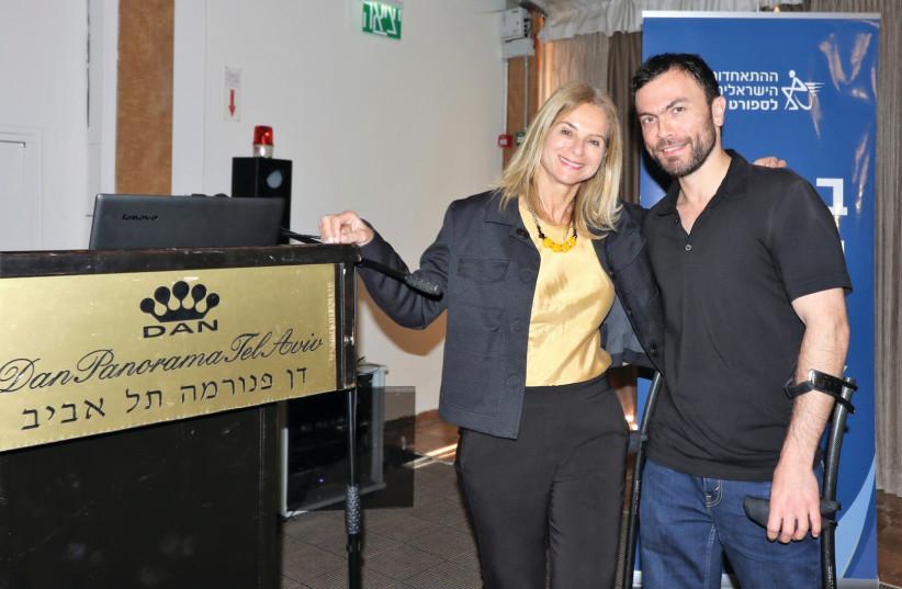 DAN HOTELS head of marketing Tali Kedar with gold medalist Noam Gershony (photo credit: KEREN ISAACSON)
