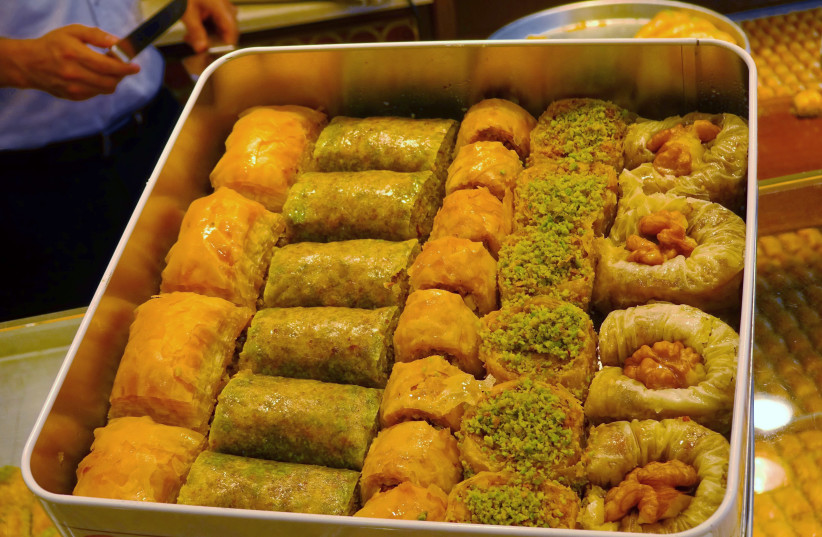 Sheets with different sweet dough particles that sells individually, or together as desired in tin cans.  (photo credit: BENREIS)