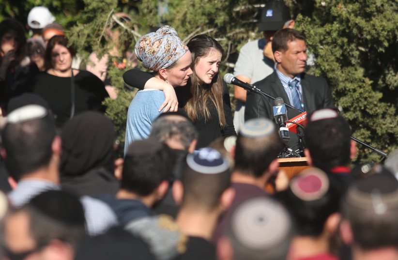 Efrat Ettinger (R) delivers a eulogy for her father, Rabbi Ahiad Ettinger, in the West Bank settlement of Eli, March 18th, 2019 (photo credit: MARC ISRAEL SELLEM/THE JERUSALEM POST)