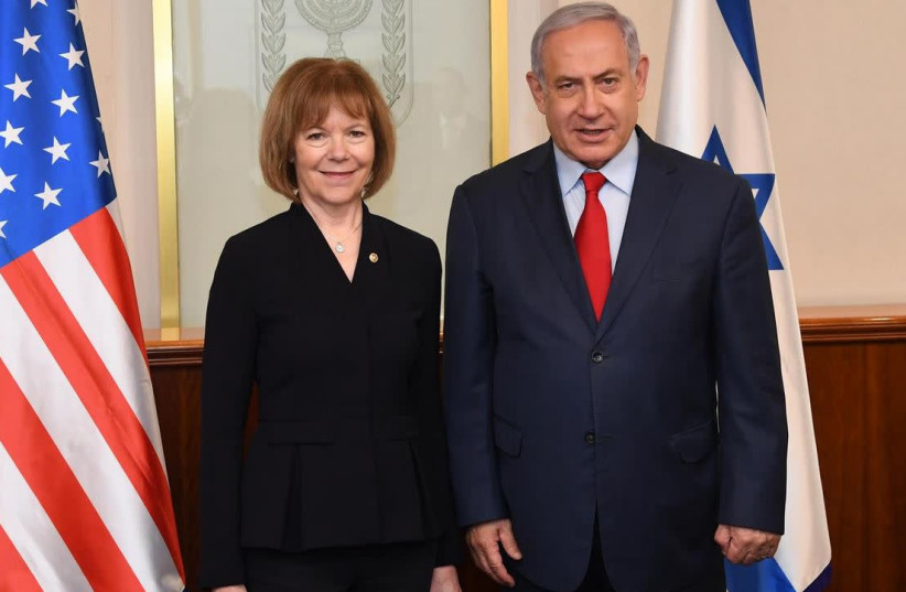 US Senator Tina Smith [D-MN] and Prime Minister Benjamin Netanyahu  (photo credit: HAIM ZACH/GPO)