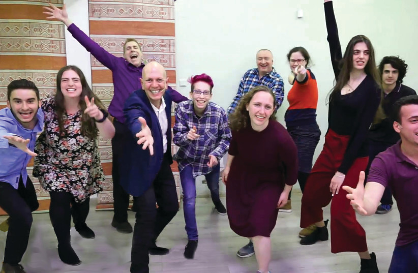 """CAST MEMBERS in the 'Shine a Light"""" sequence of 'Rewrite the World' belt out a tune during a recent rehearsal (photo credit: MEIRA ABRAMOWITZ)"""