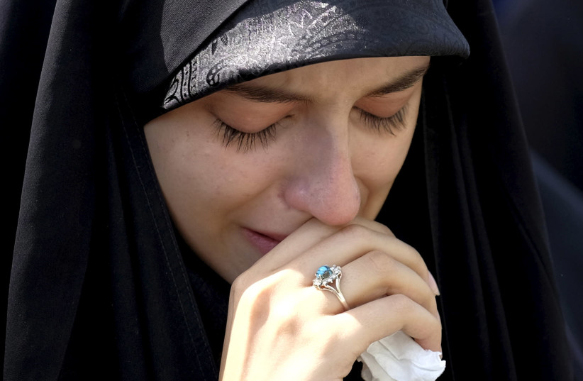 An Iranian woman mourns during the funeral of victims killed in Saudi Arabia in a stampede at the haj pilgrimage, in Tehran October 4, 2015. More than 464 Iranian nationals were killed in last month's crush in Mina, Saudi Arabia, Iran's Haj Organization says. Iranian officials have alleged the overa (photo credit: TIMA VIA REUTERS)