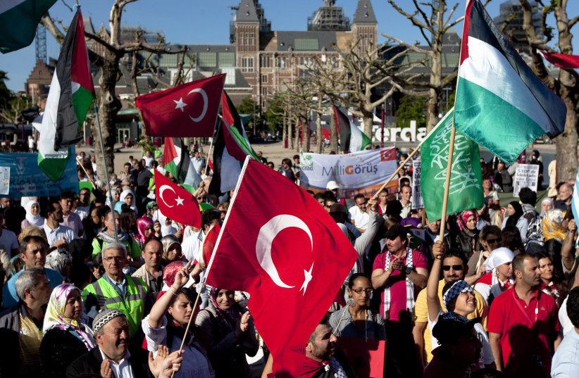 Protesters waving Turkish and Palestinian flags shout anti-Israel slogans during a demonstration in Amsterdam June 4, 2010. Israel's raid of a Gaza-bound aid flotilla has set off a diplomatic furor, drawing criticism from friends and foes alike and straining ties with regional ally Turkey, which cal (photo credit: REUTERS)