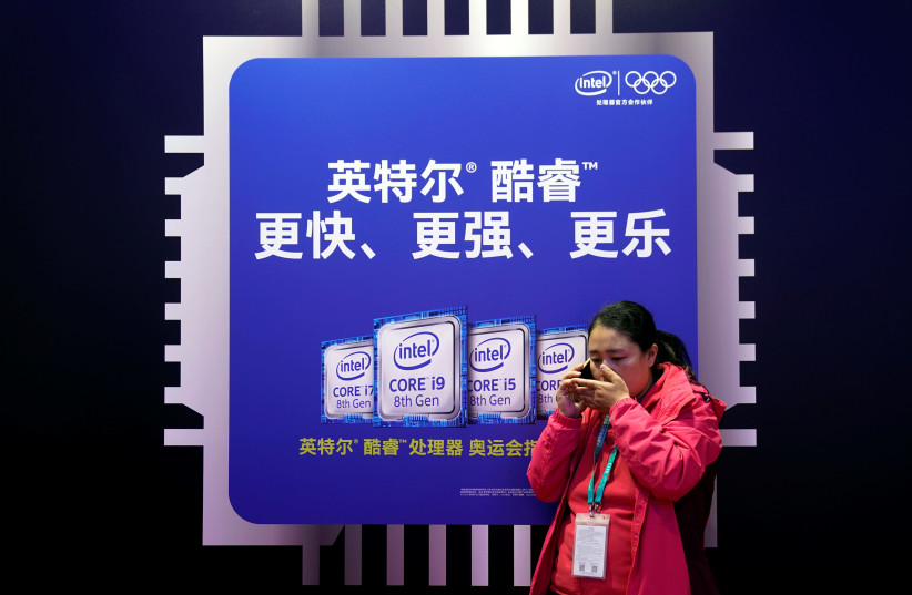 An Intel sign is seen during the China International Import Expo (CIIE), at the National Exhibition and Convention Center in Shanghai, China November 6, 2018 (photo credit: ALY SONG/REUTERS)