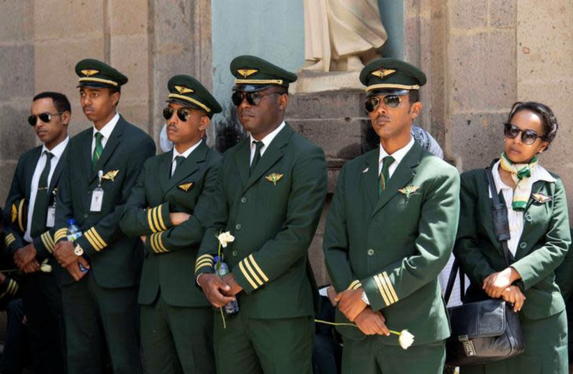 Ethiopian Airlines crew members mourn as pallbearers carry the coffins of their colleagues of the Ethiopian Airline Flight ET 302 plane crash, during the burial ceremony at the Holy Trinity Cathedral Orthodox church in Addis Ababa, Ethiopia, March 17, 2019. REUTERS/Maheder Haileselassie (photo credit: REUTERS/MAHEDER HAILESELASSIE)