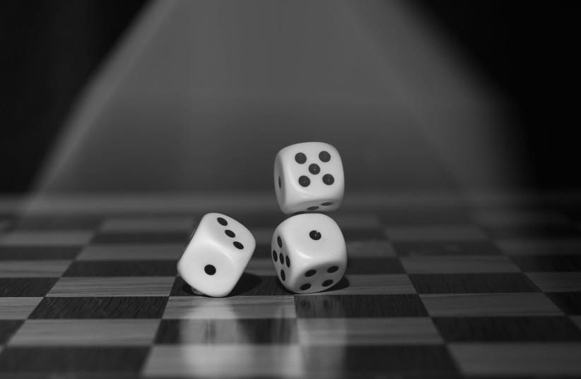 Gambling dice [Illustrative] (photo credit: PIXABAY)