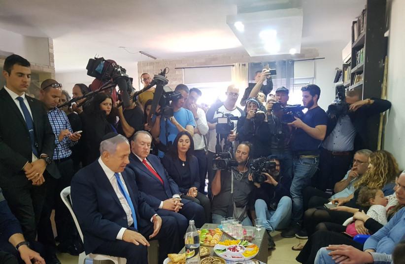 Prime Minister Benjamin Netanyhu (L) visits the shiva house of Rabbi Ahiad Ettinger, March 19th, 2019 (photo credit: TPS)