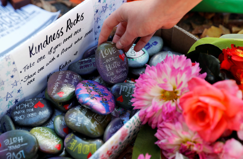 Pebbles with messages are seen at a memorial site for victims of Friday's shooting, in front of Christchurch Botanic Gardens in Christchurch, New Zealand March 19, 2019.  (photo credit: JORGE SILVA / REUTERS)