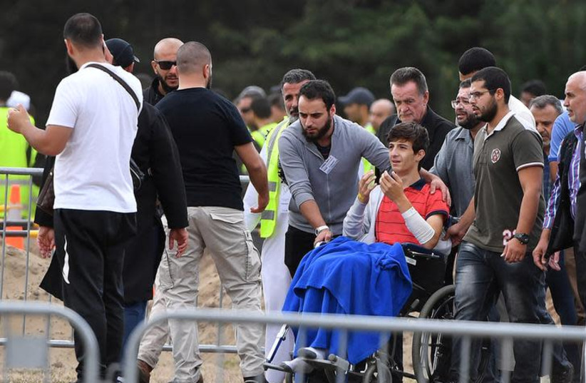 Zaid Mustafa, son and brother of mosque victims Khaled and Hamza Mustafa, leaves after their funeral, the first funerals of the 50 victims of the mosque shootings, at the Memorial Park Cemetery in Christchurch, New Zealand, March 20, 2019 (photo credit: AAP IMAGE/MICK TSIKAS/VIA REUTERS)