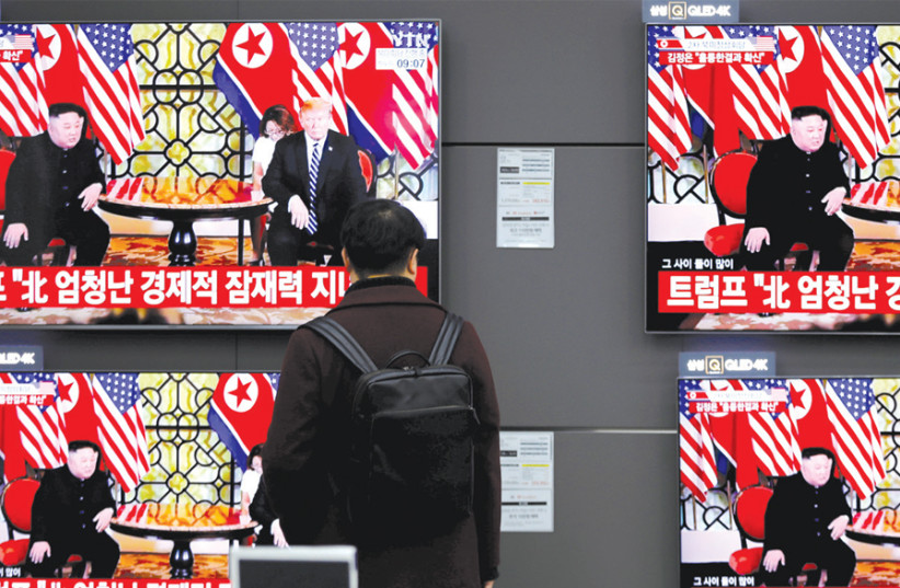 A PASSERBY watches a broadcast on the Hanoi summit between North Korean leader Kim Jong-un and US President Donald Trump, in Seoul, South Korea, on February 28. (photo credit: REUTERS)
