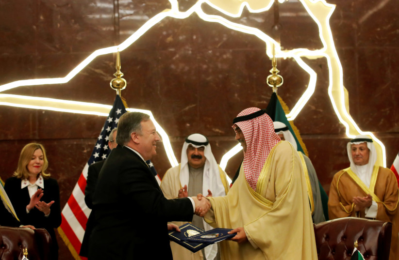 U.S. Secretary of State Mike Pompeo shakes hands with Kuwait's Foreign Minister Sheikh Sabah Al-Khalid Al-Sabah in Kuwait, March 20, 2019 (photo credit: JIM YOUNG/REUTERS)