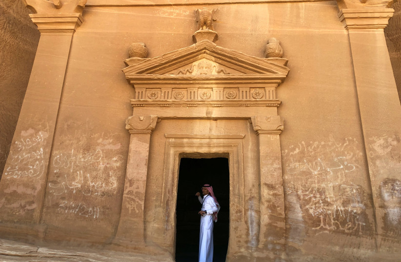 A Saudi tour guide stands inside a tomb at al-Ula (REUTERS/Stephen Kalin) (photo credit: REUTERS/STEPHEN KALIN)