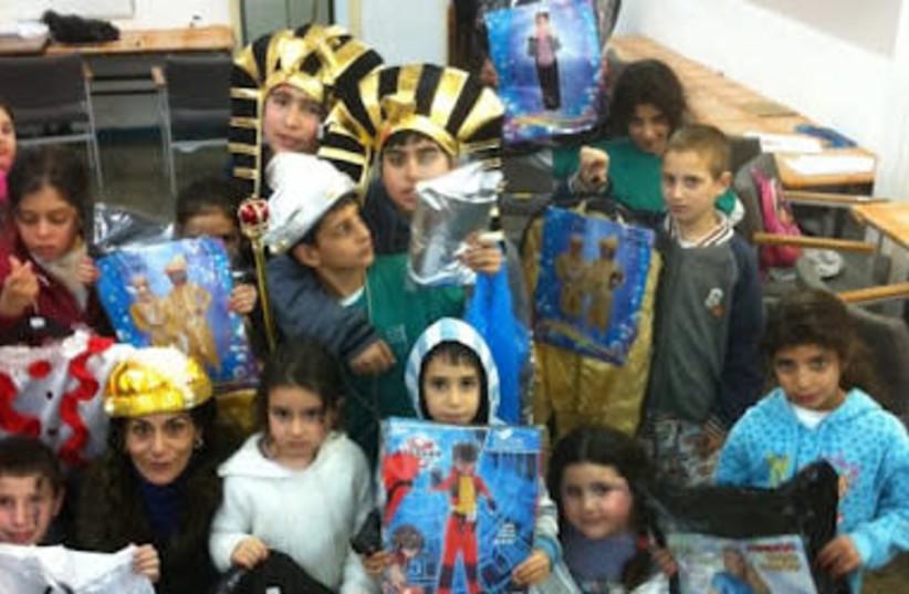 Meir Panim celebrates Purim (photo credit: MEIR PANIM)