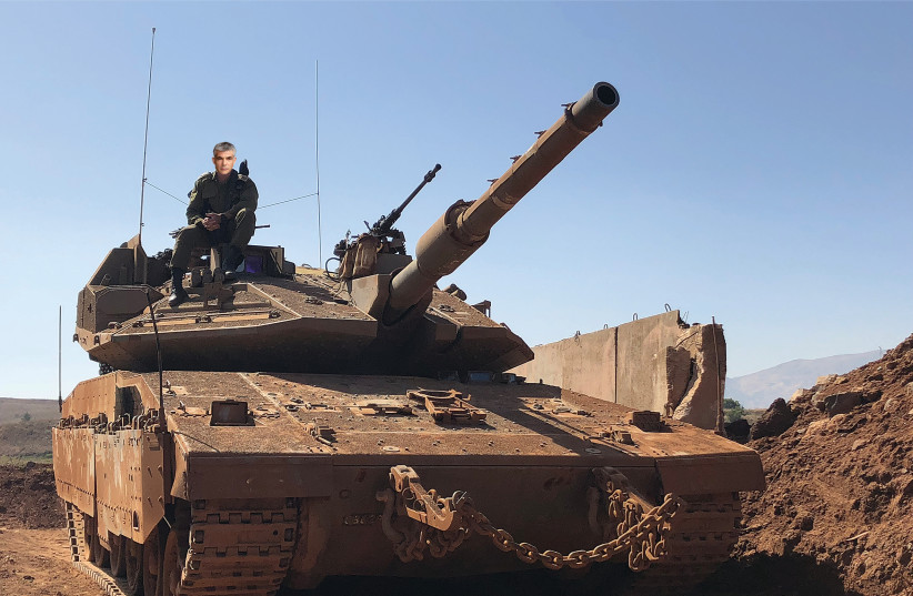 YAIR LAPID searches for the coffee machine in his IDF-assigned tank (photo credit: IDF SPOKEWHEEL)