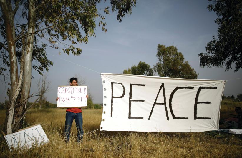 Israeli peace activist on the Gaza border. (photo credit: REUTERS)