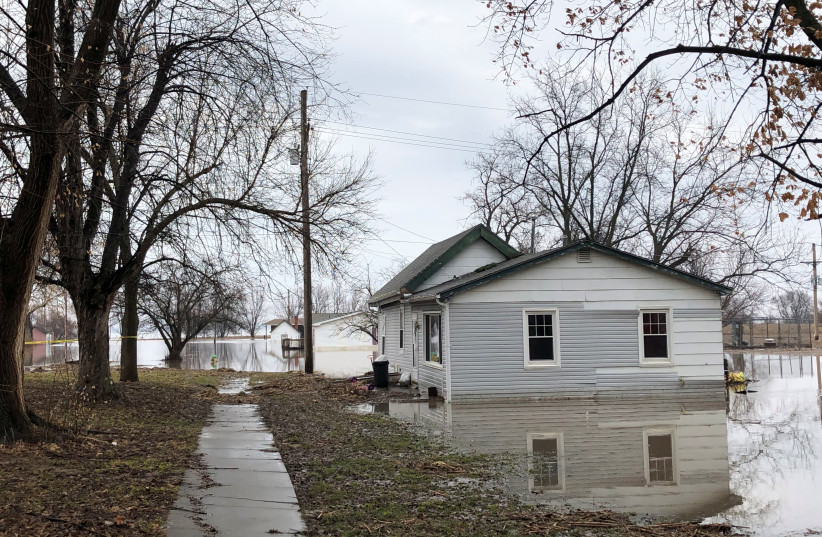 Homes sit in flood waters after leaving casualities and causing hundreds of millions of dollars in damages, with waters yet to crest in parts of the U.S. midwest, in Peru, Nebraska, U.S., March 19, 2019 (photo credit: REUTERS/KAREN DILLON)