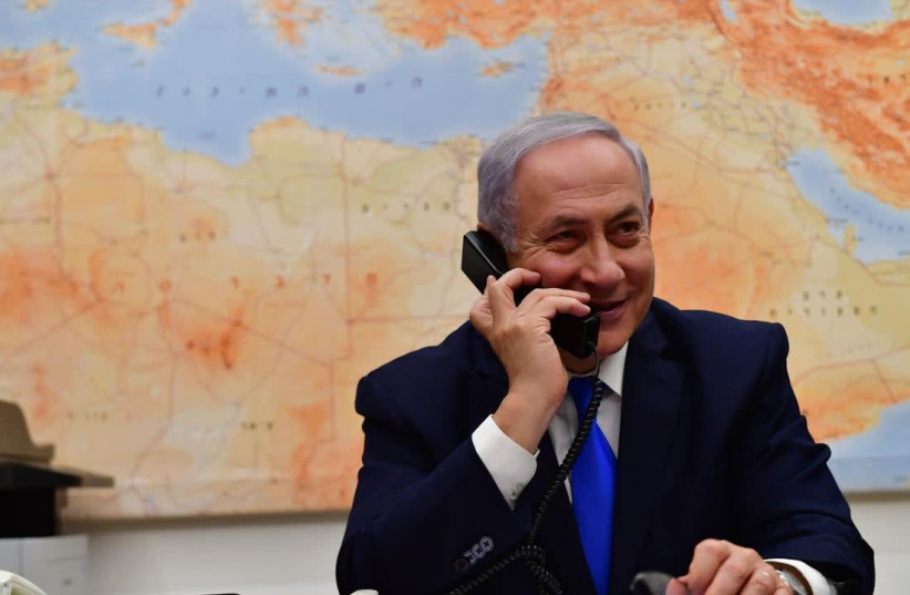 Prime Minister Benjamin Netanyahu speaking over the phone with U.S. President Donald Trump, after the latter called for US recognition of Israeli soverignty over the Golan Heights, March 21, 2019 (photo credit: KOBI GIDEON/GPO)