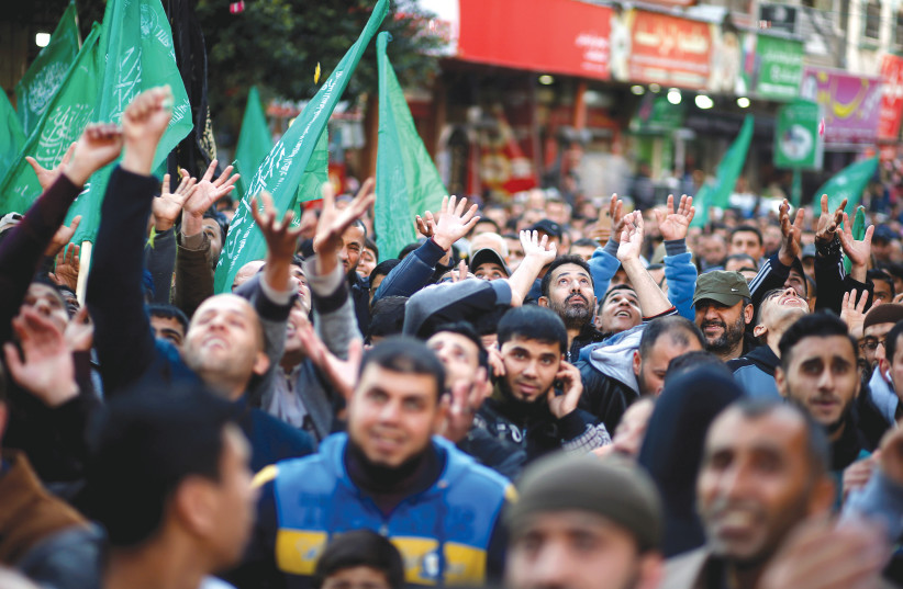 PALESTINIAN HAMAS SUPPORTERS in Gaza celebrate the Ariel terrorist attack, earlier this week (photo credit: MOHAMMED SALEM/ REUTERS)
