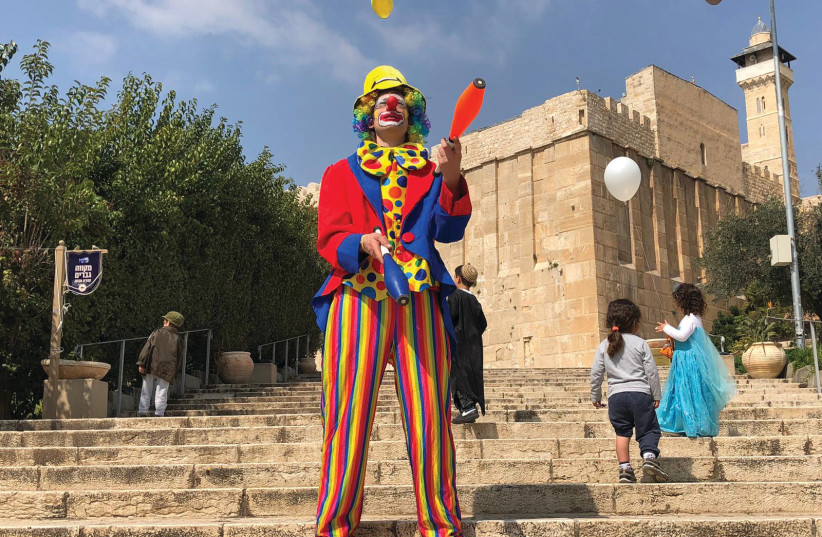CELEBRATING PURIM outside the Tomb of the Patriarchs in Hebron (photo credit: TOVAH LAZAROFF)