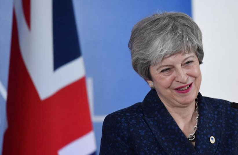 Britain's Prime Minister Theresa May gives a news briefing after meeting with EU leaders in Brussels, Belgium May 22, 2019 (photo credit: REUTERS/TOBY MELVILLE)