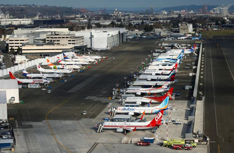 An aerial photo shows several Boeing 737 MAX airplanes grounded at Boeing Field in Seattle, Washington, U.S. March 21, 2019 (photo credit: REUTERS/LINDSEY WASSON)