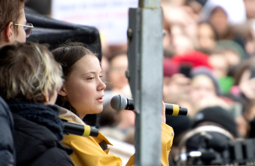 "Activist Greta Thunberg speaks during the global demonstration ""Global strike for future"" in central Stockholm, Sweden, March 15, 2019. (photo credit: HENRIK MONTGOMERY / TT NEWS AGENCY VIA REUTERS)"