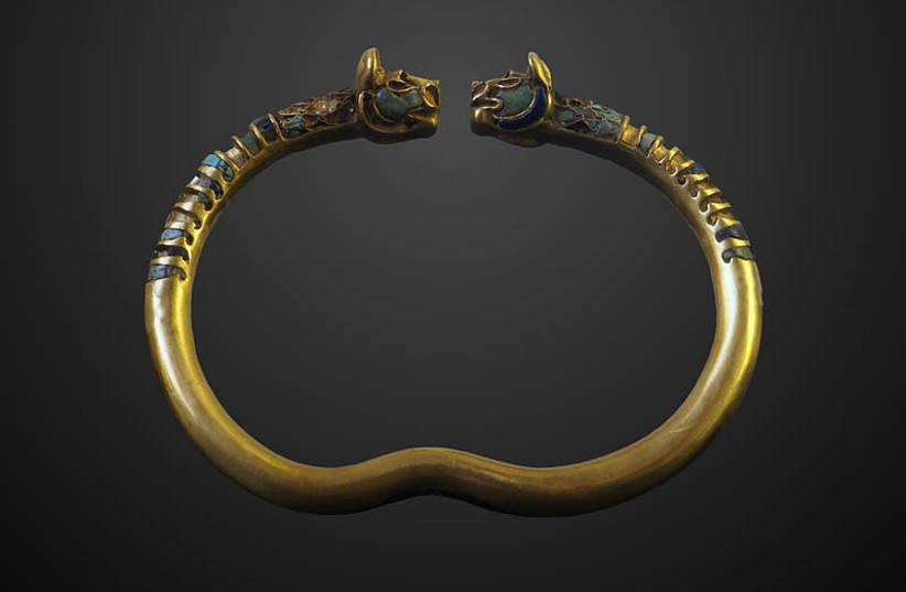 Bracelet ornated with a pair of lion heads found in Susa  (photo credit: Wikimedia Commons)