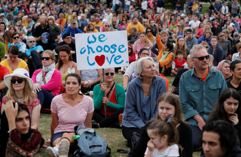 """People take part in the """"March for Love"""" at North Hagley Park after the last week's mosque attacks in Christchurch, New Zealand March 23, 2019. (photo credit: JORGE SILVA / REUTERS)"""