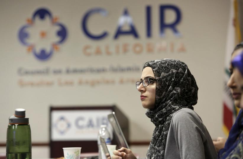 Student watches the Republican presidential debate at the CAIR office (REUTERS/Jason Redmond) (photo credit: REUTERS/JASON REDMOND)
