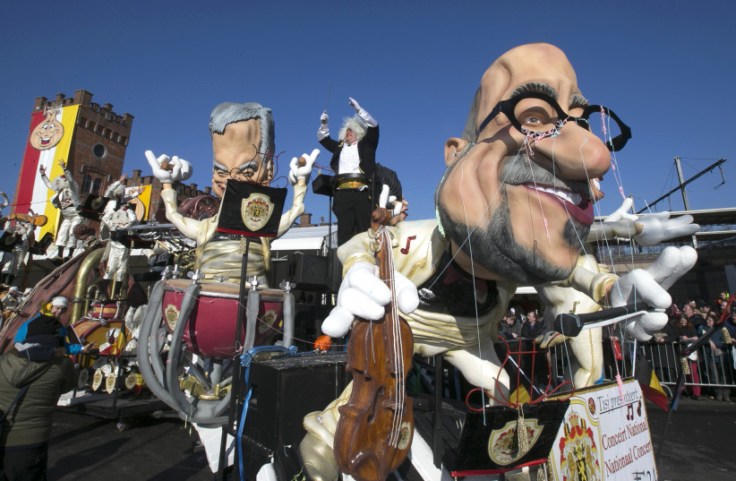 Giant figures are seen during the 87th carnival parade of Aalst February 15, 2015 (photo credit: REUTERS/YVES HERMAN)