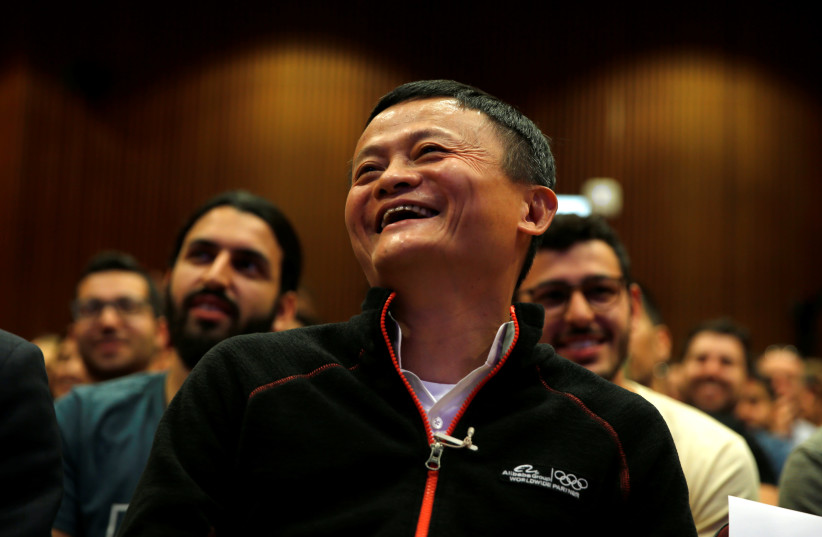 Jack Ma, founder of Chinese e-commerce giant Alibaba, laughs during an event at the Tel Aviv University, Israel May 3, 2018 (photo credit: AMIR COHEN/REUTERS)