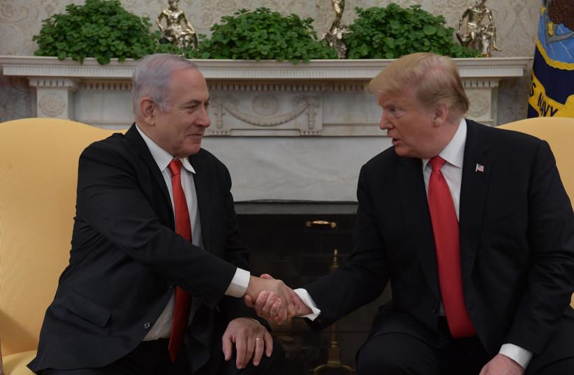 Prime Minister Benjamin Netanyahu and US President Donald Trump meet in Washington, on March 25, 2019 (photo credit: AMOS BEN-GERSHOM/GPO)
