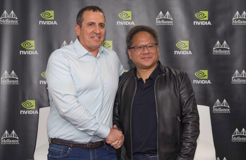 Mellanox Technologies CEO Eyal Waldman (L) and Nvidia CEO Jason Huang (photo credit: OMER TAL)