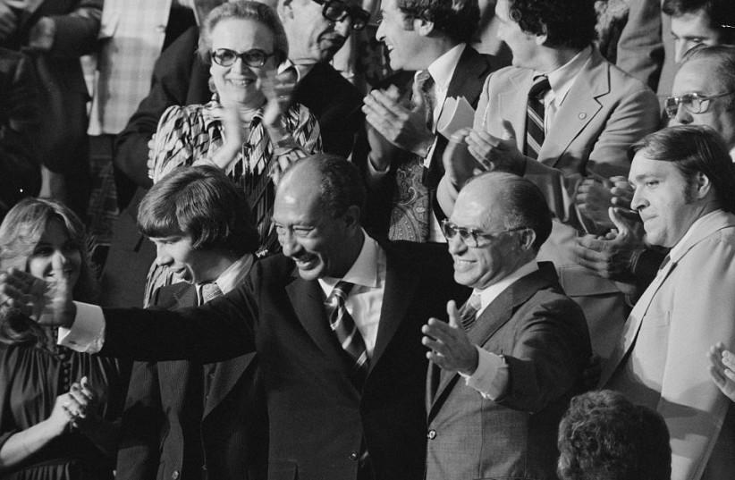 THEN-PRIME MINISTER Menachem Begin, with Egyptian leader Anwar Sadat, visit Congress in 1978 (photo credit: REUTERS)