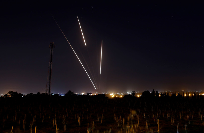 Streaks of light are pictured as rockets are launched from the Gaza Strip towards Israel, as seen from the Israeli side of the border March 25, 2019 (photo credit: REUTERS/AMIR COHEN)