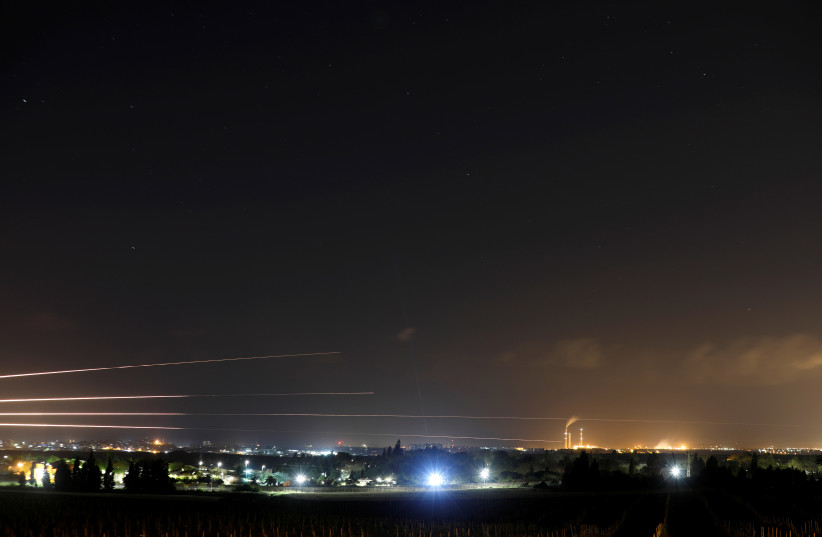 Streaks of light are pictured as rockets are launched from the Gaza Strip towards Israel, as seen from the Israeli side of the border March 25, 2019 (photo credit: AMIR COHEN/REUTERS)