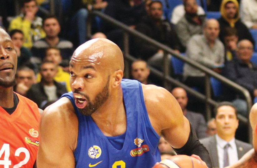 ALEX TYUS led Maccabi Tel Aviv with 21 points in the yellow-and-blue's 86-74 home victory over Ness Ziona in BSL action on Monday night (photo credit: ADI AVISHAI)