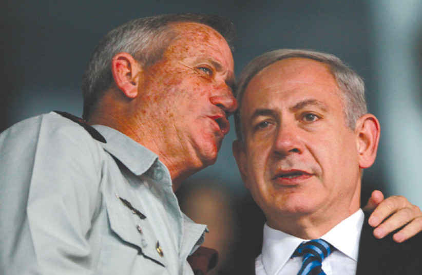 PRIME MINISTER Benjamin Netanyahu and then-IDF chief of staff Benny Gantz speak in 2013. One of them will likely be asked to form the next government (photo credit: BAZ RATNER/REUTERS)