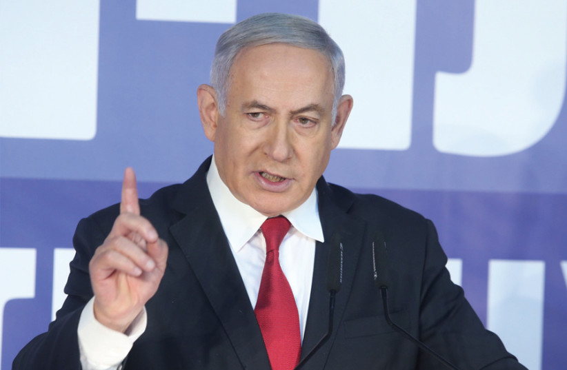 Netanyahu speaking at a recent election campaign event (photo credit: MARC ISRAEL SELLEM)