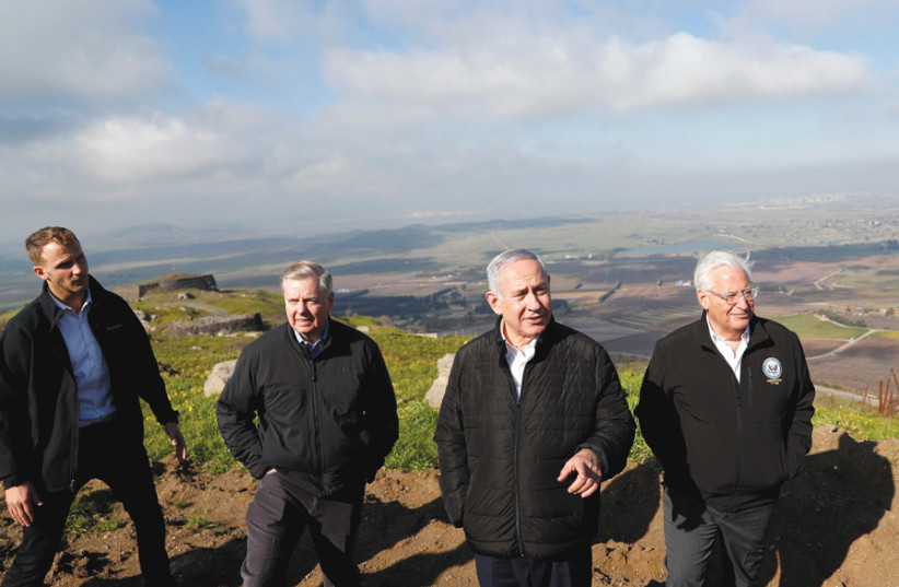 Prime Minister Benjamin Netanyahu (center) takes Senator Lindsey Graham and US Ambassador to Israel David Friedman on a tour of the Golan Heights on March 11 (photo credit: RONEN ZVULUN / REUTERS)