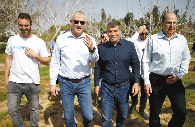 Benny Gantz, head of the Blue and White Party, visits Kibbutz Kfar Aza near the Gaza Strip on March 13 with party candidates Gabi Ashkenazy and Moshe Ya'alon (photo credit: AMIR COHEN/REUTERS)